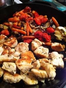 Shove the cooked chicken over to make room to reheat your roasted veggies